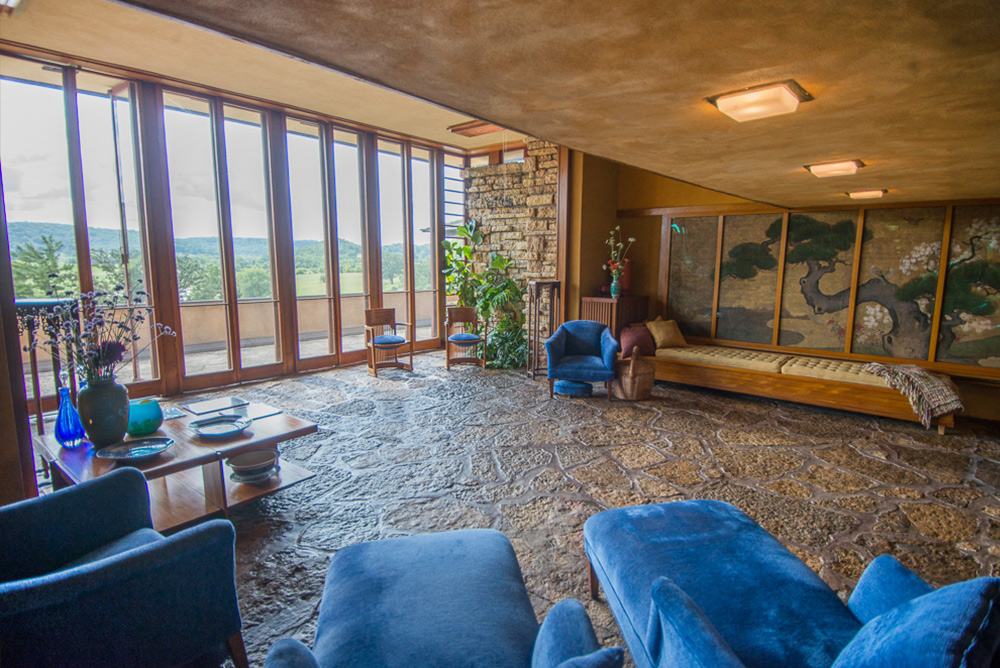 Interior shot of Taliesin living room blue cushions Frank Lloyd Wright