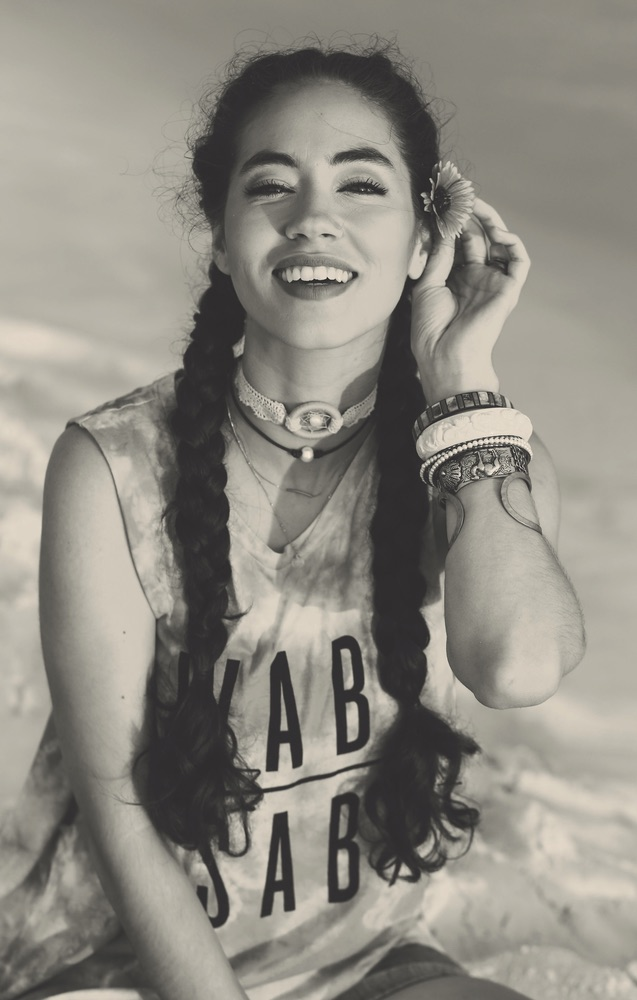 Model on the beach wearing a Graceful Rebel tank Wabi Sabi inspiring women