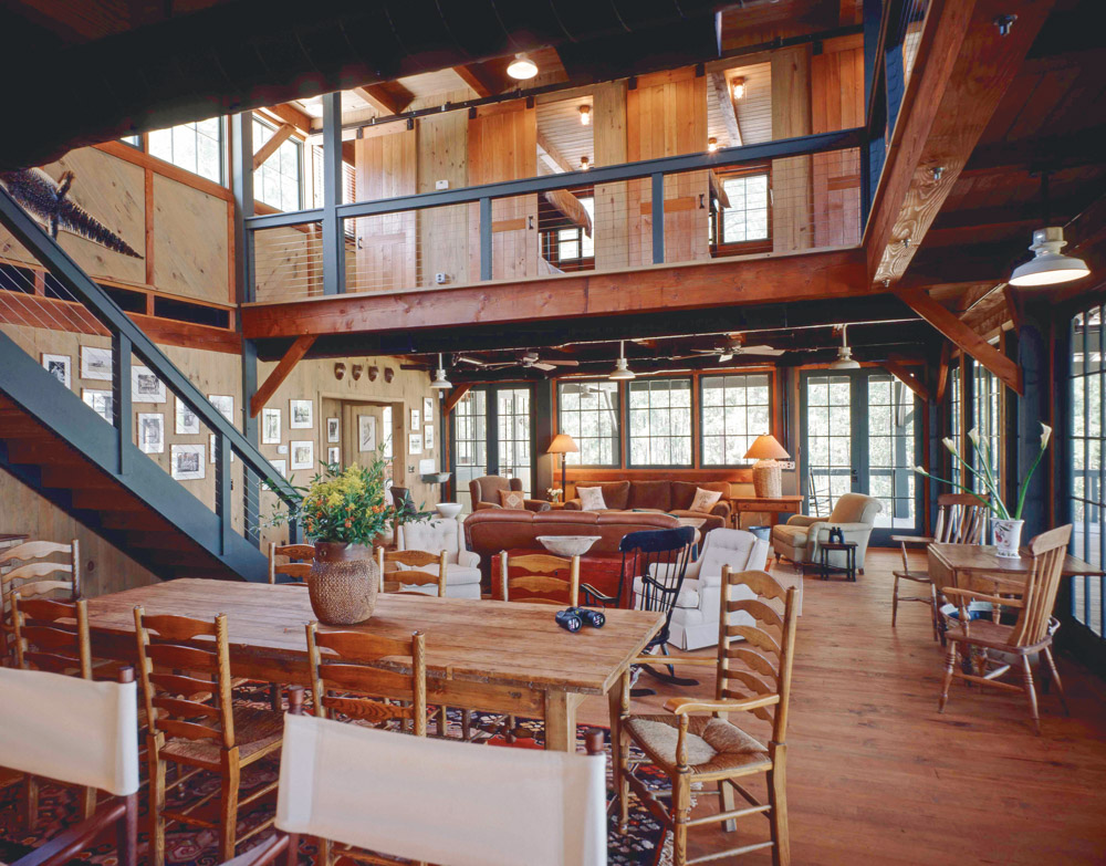 True timber-frame construction and the sturdy simplicity of post-and-beam carpentry are evident in the Oyster House, the island's riverfront sporting lodge. Photo by Richard Leo Johnson