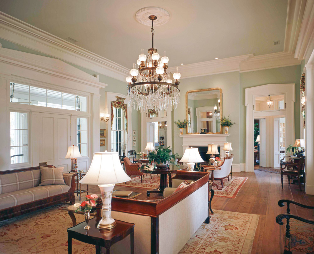 Tapered architraves in the classical Greek Revival style frame the windows and doors of the receiving room, which fills the depth of the home. Photo by Richard Leo Johnson
