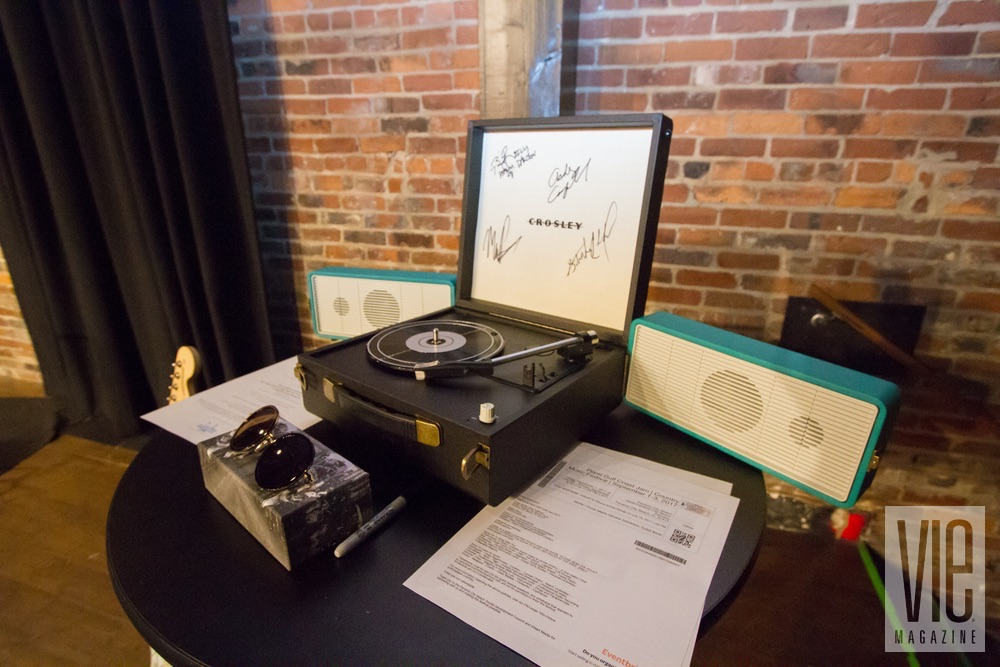 Live auction item, a Crosley Snap Turntable, signed by all our performers at VIE Magazine's