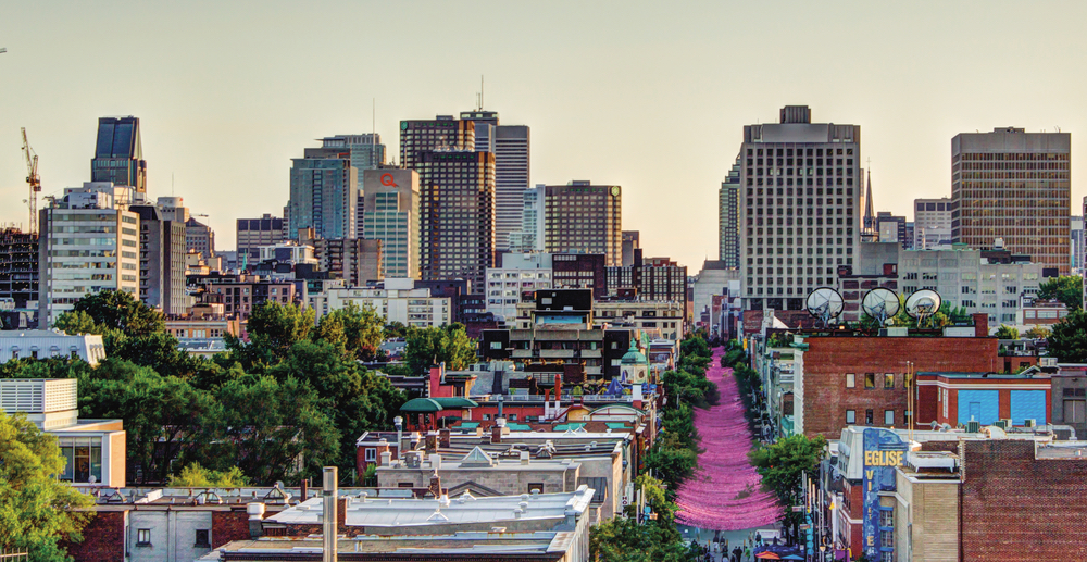 The pedestrian-only Gay Village district along Rue Sainte-Catherine is adorned with pink streamers, street vendors, nightclubs, and much more. Photo by Frédérick Plante, Montreal Tourism