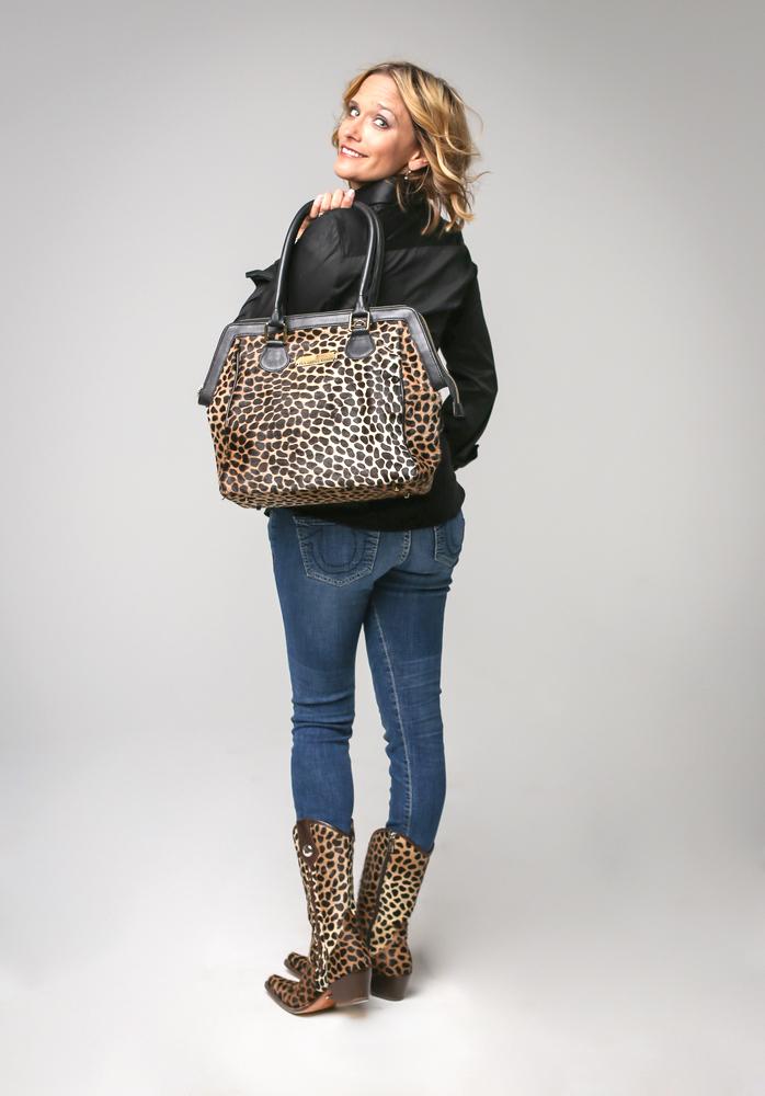 Model showing off her Rockwell Tharp leather handbag