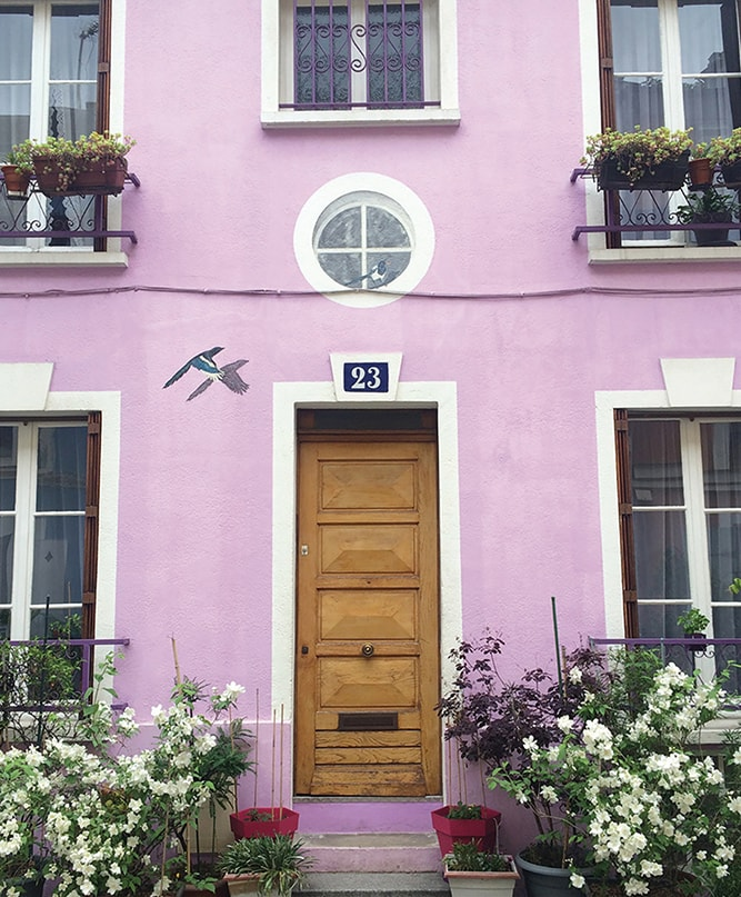 Doorways of Paris photographed by Rachel Puig pink building Parisian architecture