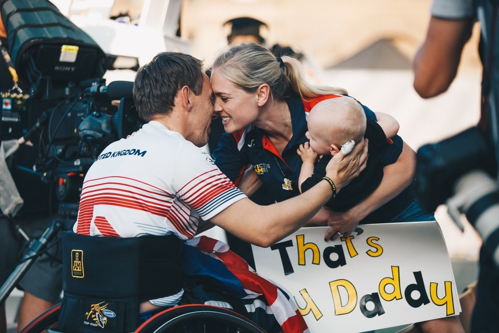 United Kingdom WheelChair Tennis player embraces wife and child after match at the Invictus Games 2017 Toronto