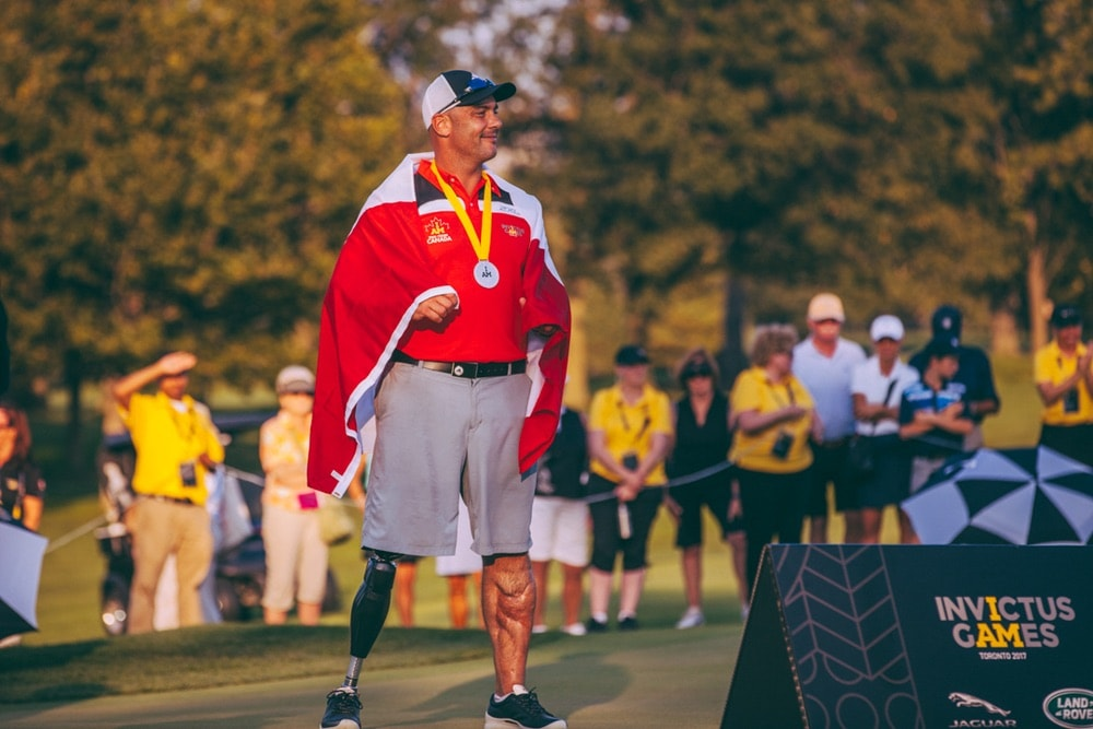 Golfer medalist standing on green after competing at the Invictus Games 2017 Toronto