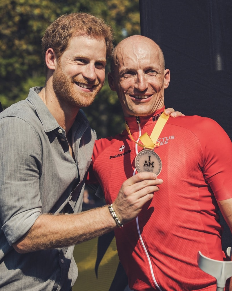Prince Harry congratulates bronze medalist Thomas Stuber of Germany after Stuber competed in the cycling time trial at the Invictus Games 2017 Toronto