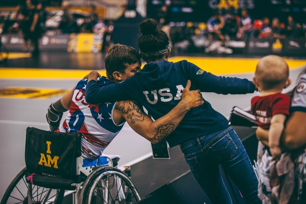Member of the USA Wheelchair Basketball team gives hug to his supporter in the stands at the Invictus Games 2017 Toronto