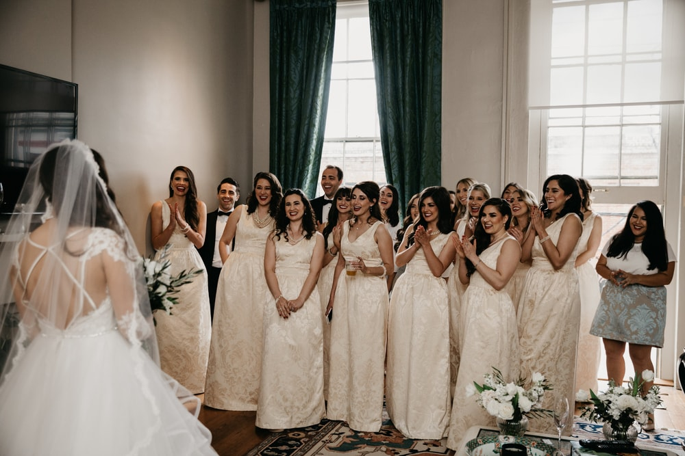 Sarah Elizabeth's bridesmaids see the bride in her gown for the first time