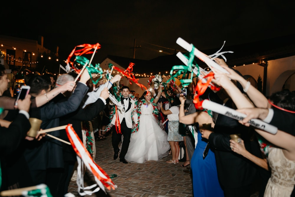A big New Orleans wedding celebration parade on the streets of New Orleans