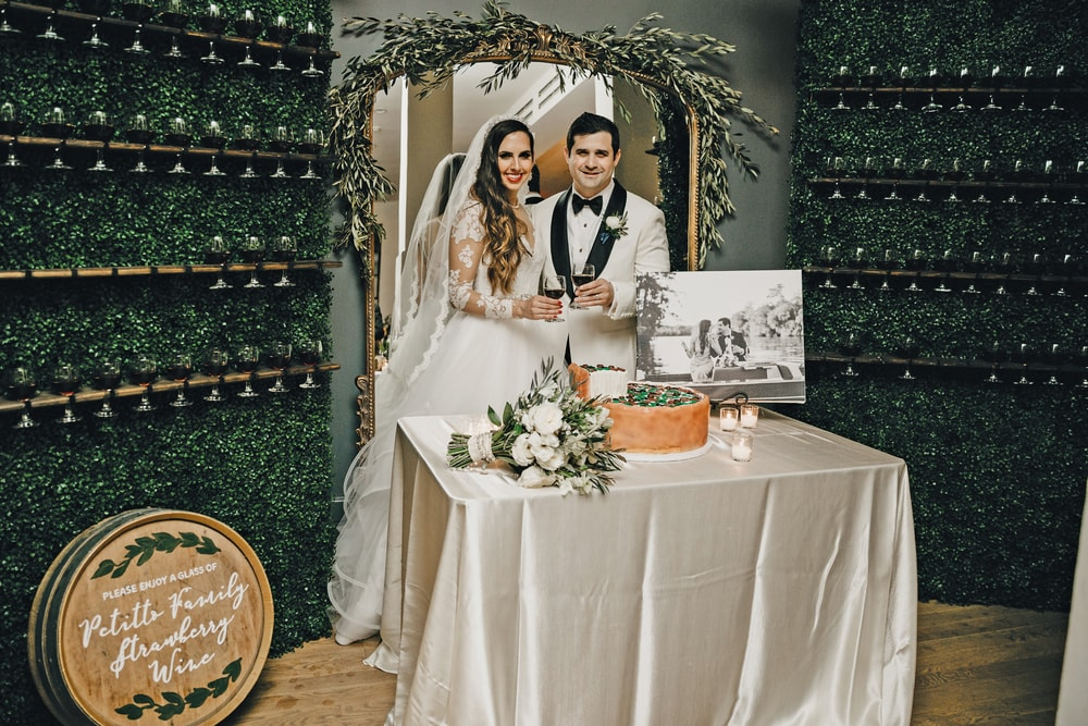 Sarah Elizabeth and Phillip Petitto cutting the grooms pizza cake at their big New Orleans Wedding