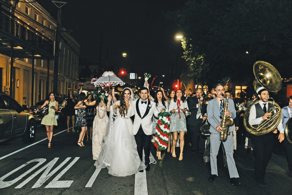 Parade line followed by the newlyweds from St. Mary's Assumption Catholic Church to Il Mercato