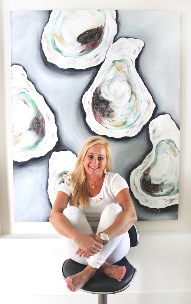 Portrait of artist Amy Fogg in front of her oyster painting