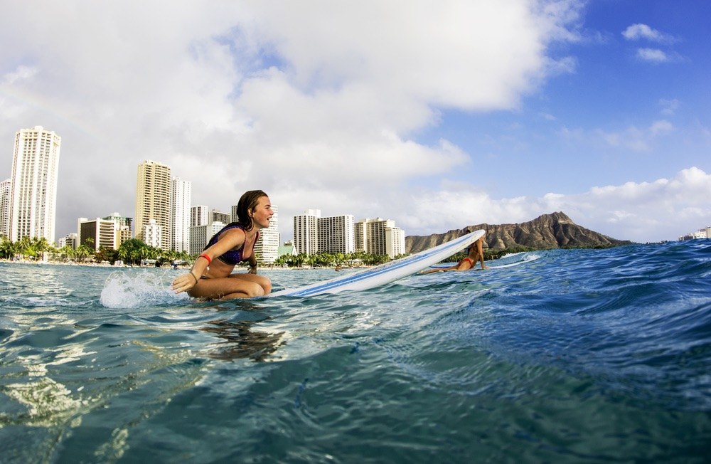 surfers wait for breaking waves off Waikiki Beach, Hawaii