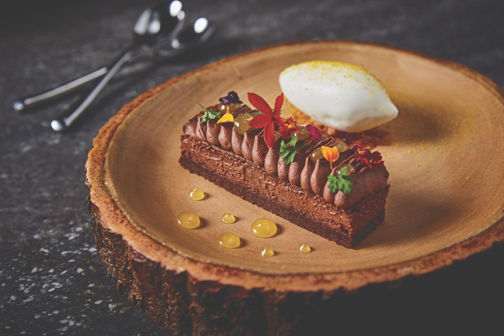 If you've got a sweet tooth, stop by Stubborn Seed for the croustillant, a decadent chocolate layer cake. Photo courtesy of Grove Bay Hospitality