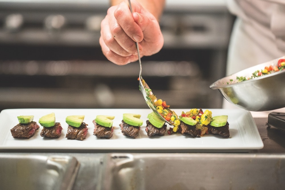 Chef Aaron Brooks plating a succulent steak dish at EDGE, Steak and Bar. Photo courtesy of EDGE, Steak and Bar