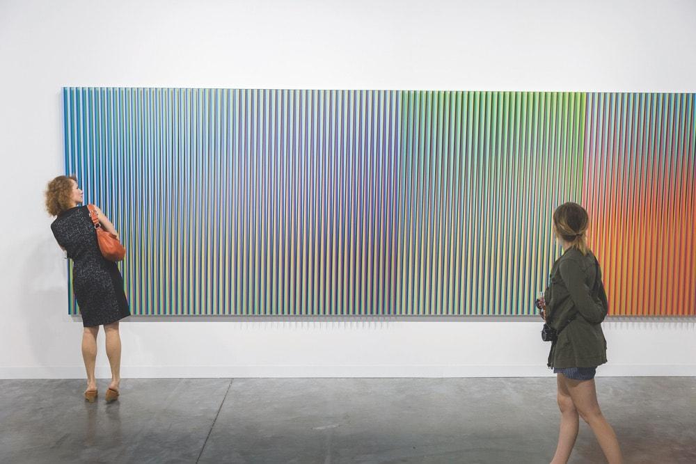 People viewing Carlos Cruz-Diez's piece Physichromie Panam N° 259 at the Sicardi Gallery. Photo courtesy of Art Basel