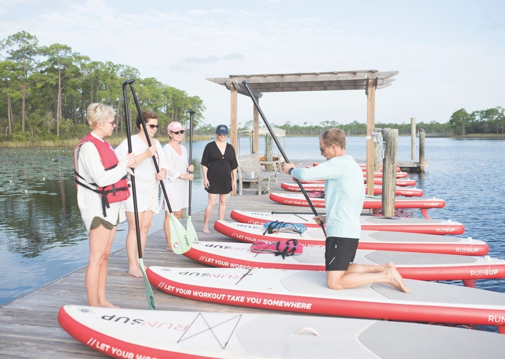 Stand-up paddleboarding lessons with RUN/SUP at WaterColor Boathouse at The Southern C Retreat in WaterColor Florida