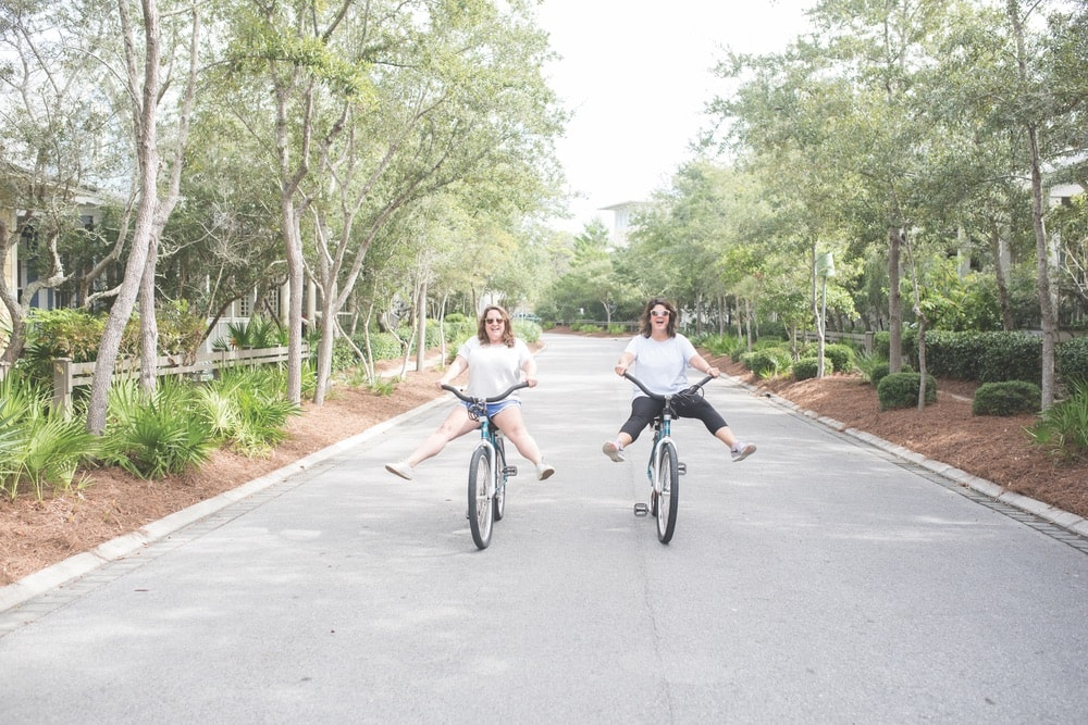 The Southern C founders Cheri Leavy and Whitney Long riding bikes in WaterColor