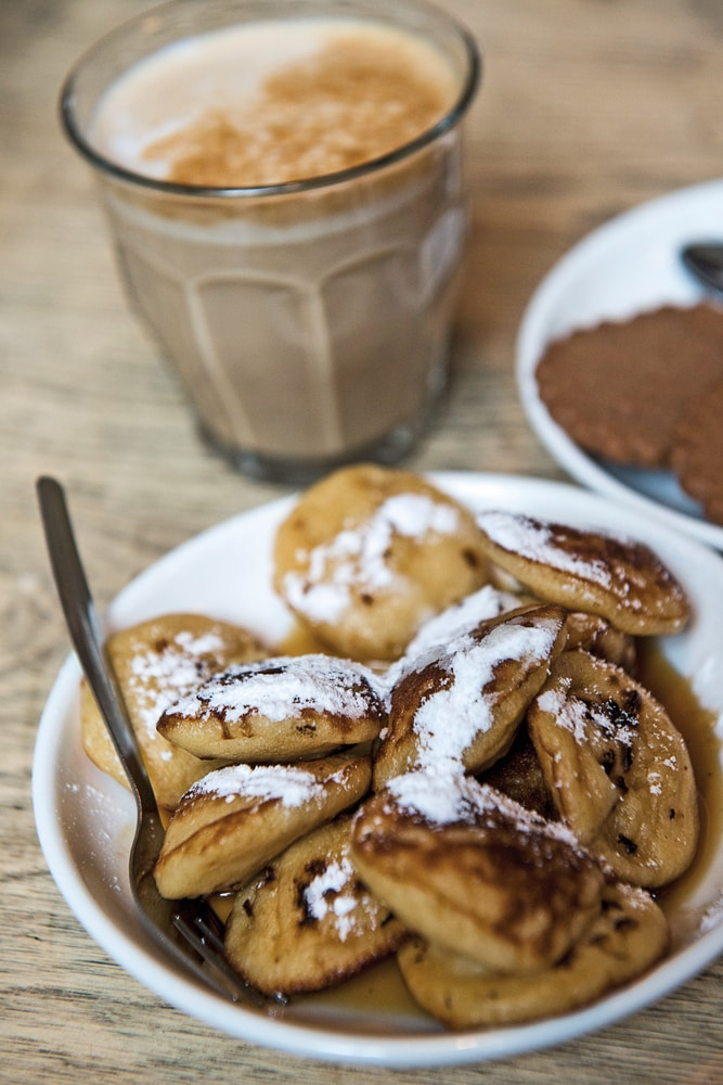Another culinary favorite in Amsterdam are sugary mini pancakes called poffertjes Amsterdam Food VIE Magazine Destination Travel 2018