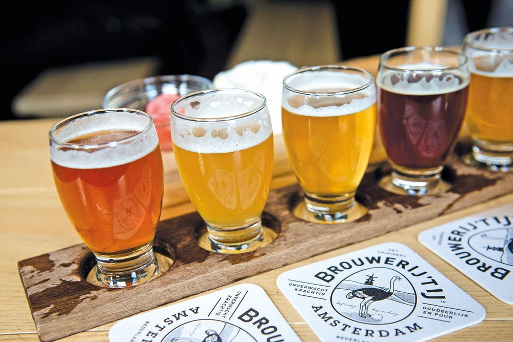 Brouwerij 't IJ offers a flight of four organic beers Amsterdam Food VIE Magazine Destination Travel 2018
