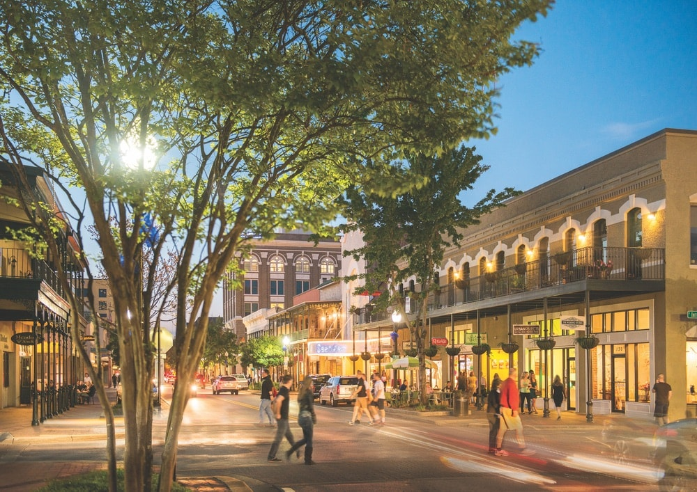 Northwest Florida's Gulf Coast, Emerald Coast, features great locations for shopping. Downtown Pensacola's Palafox Street is in the center of town and this images shows many people walking to shops and restaurants.