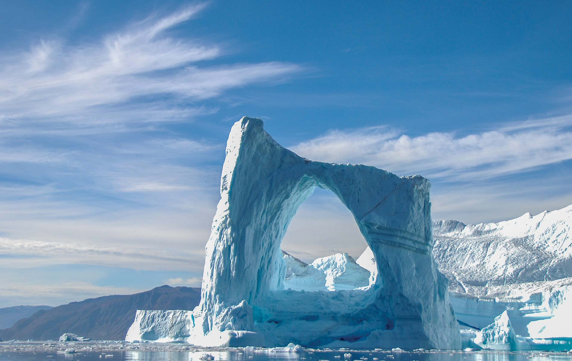A cruise around Greenland will offer many incredible sights, such as this majestic arched iceberg.