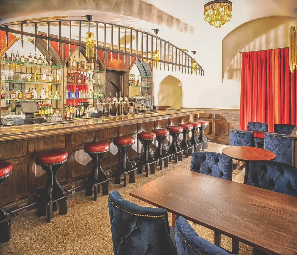 Guests can enjoy a drink with medieval flair at the castle's pub.