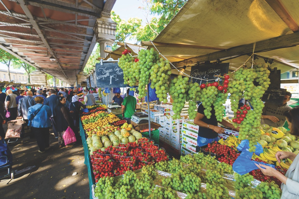 Sumptuous fruits and other fresh produce at an open-air market in Paris Photo by Sorbis / Shutterstock