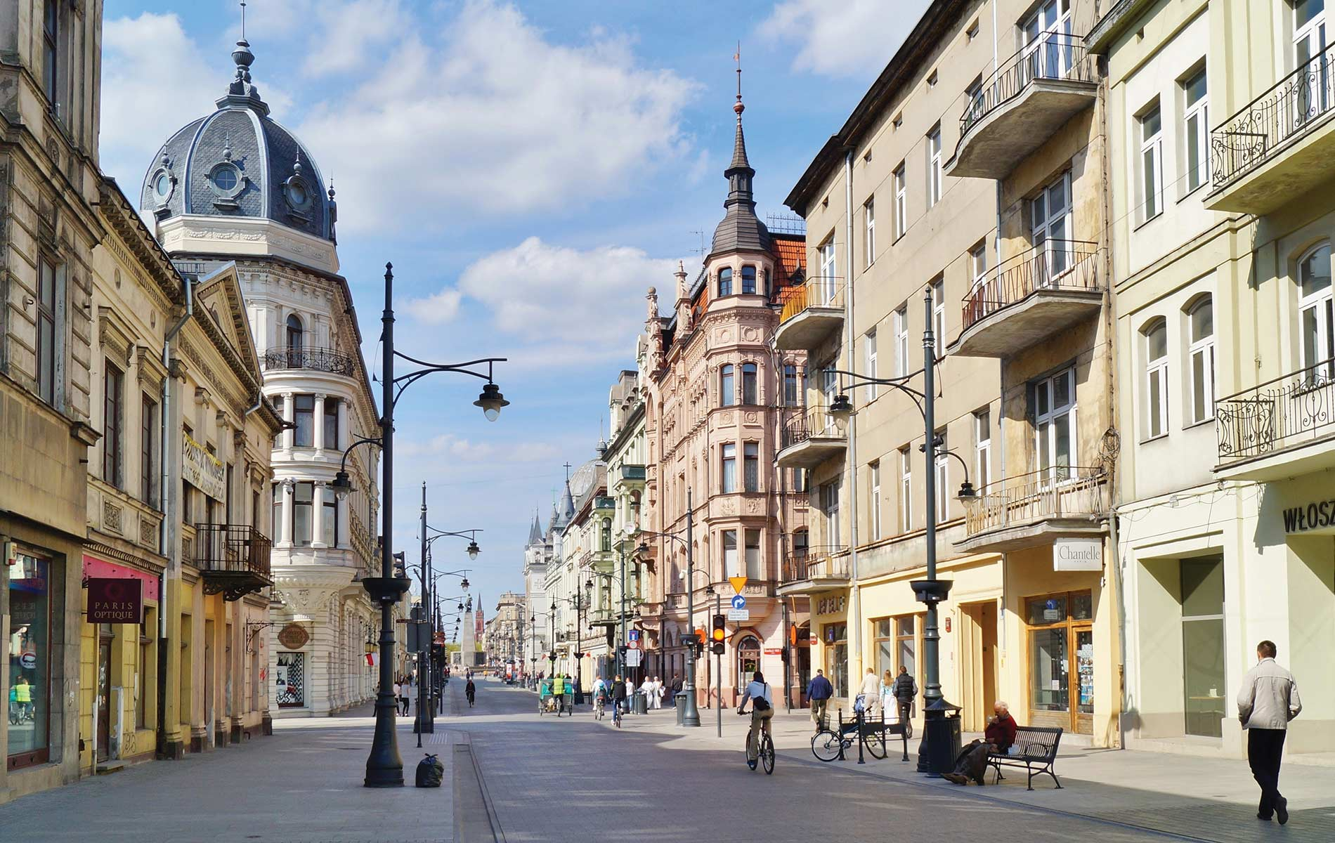 Passersby enjoy a sunny Sunday afternoon on Piotrkowska Street in Lodz. Photo by Mariola Anna S / Shutterstock