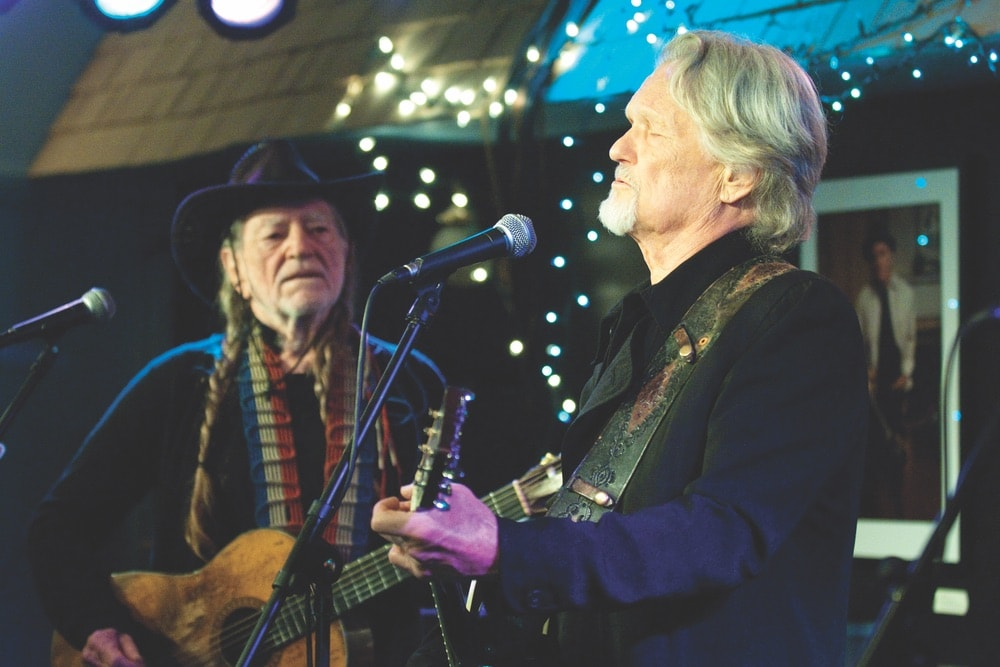 Country legends Willie Nelson and Kris Kristofferson perform at the Bluebird Cafe. Photo courtesy of Bluebird Cafe