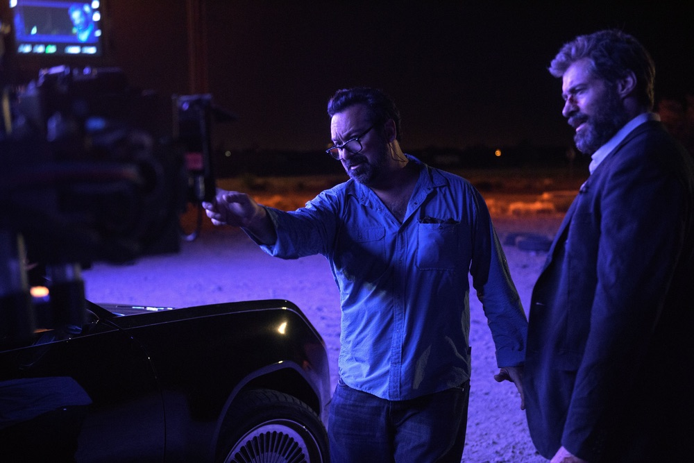 Director James Mangold and Hugh Jackman (Logan) on the set of LOGAN. Photo Credit: Ben Rothstein.