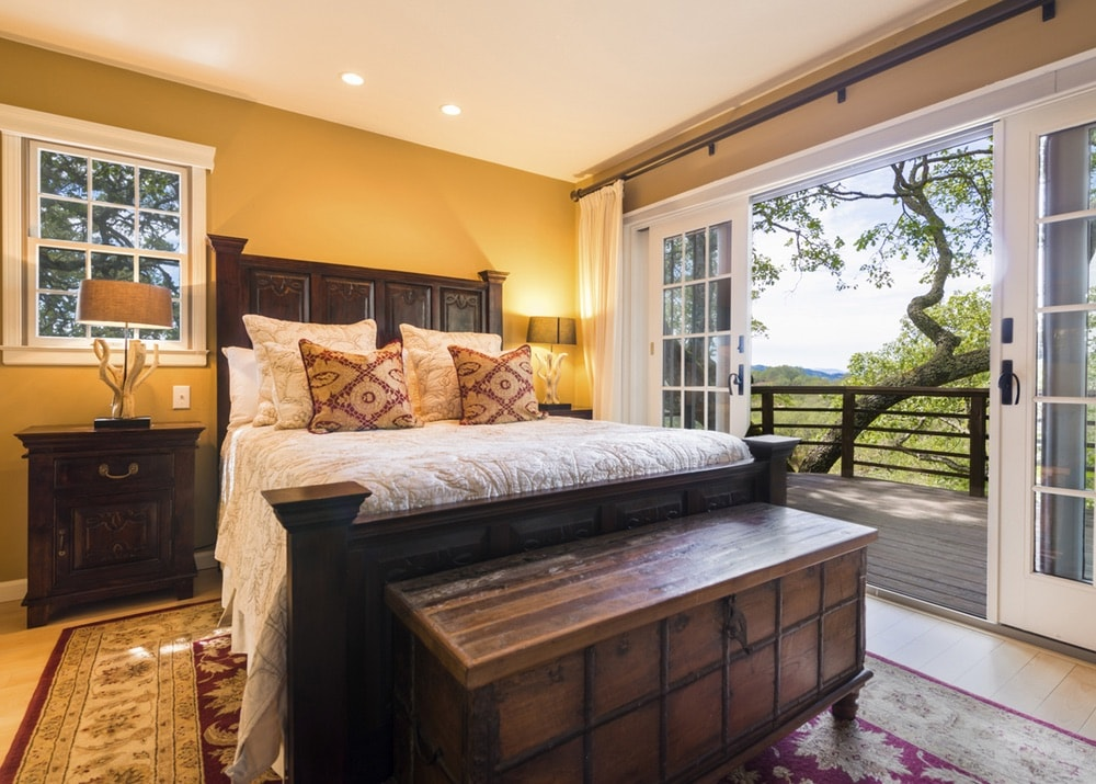 Jordan Vineyard and Winery; One of the guest bedrooms with a view overlooking the vineyard in Sonoma County, California.