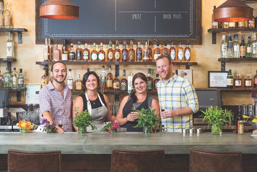 Sonoma County, California; Bartenders behind the bar at Duke's Spirited Cocktails