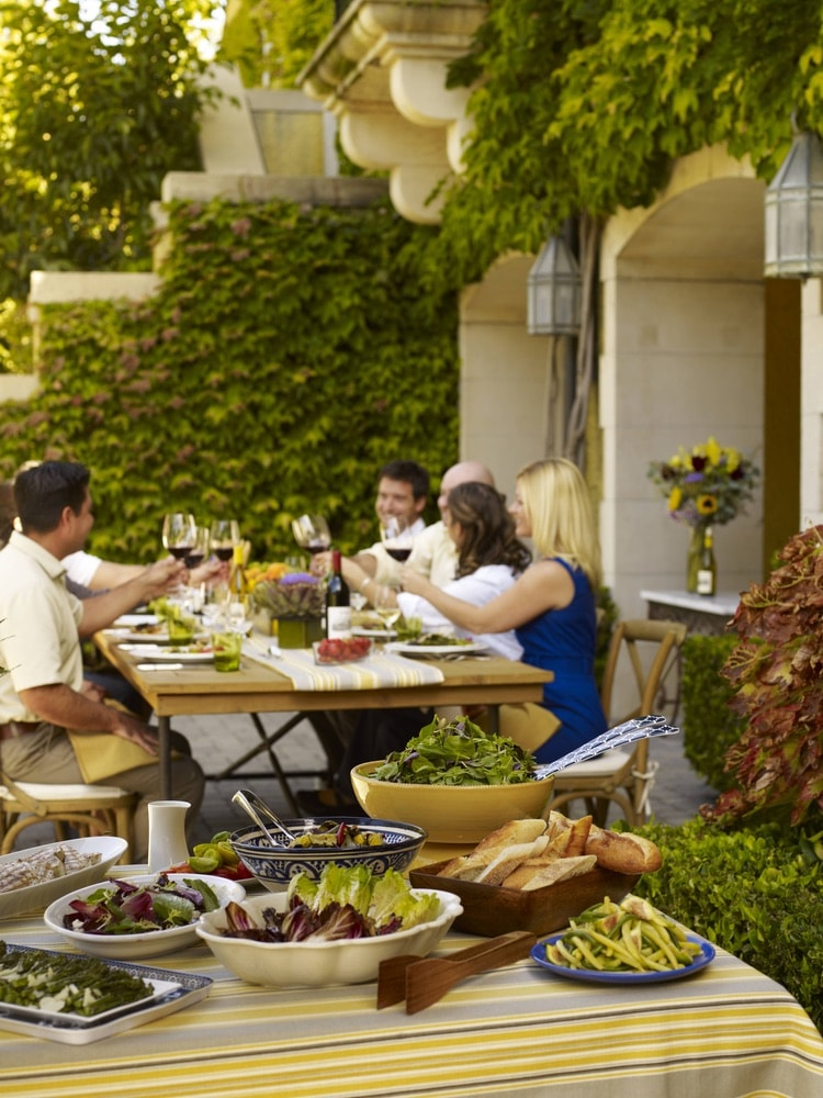 Jordan Vineyard and Winery; Group of people enjoying a dining experience and wine pairing on the vineyard grounds in Sonoma County, California.