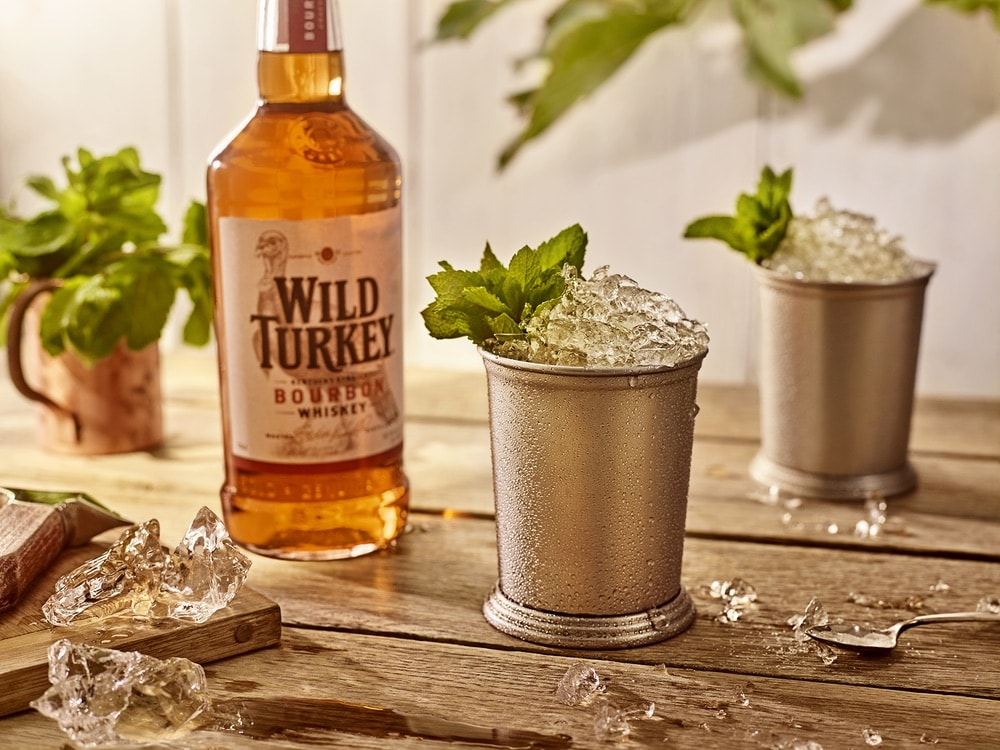 Mint Julep cocktails and a bottle of Wild Turkey