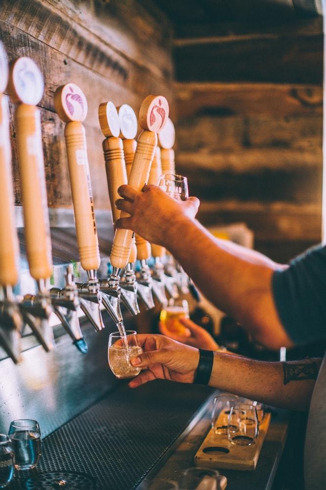 Beer being poured at GoodRoad CiderWorks in Charlotte, North Carolina