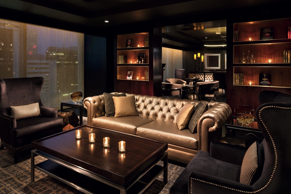 The Punch Room bar sitting area with a gold couch at the Ritz Carlton in Charlotte, North Carolina