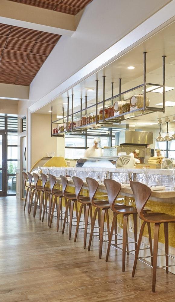 Interior bar sitting area at Emeril's Coastal Italian at Grand Boulevard in Miramar Beach, Florida