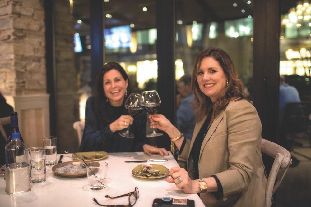 Jennifer Carter and Alden Lagasse enjoying wine at Emeril's Coastal Italian at Grand Boulevard in Miramar Beach, Florida