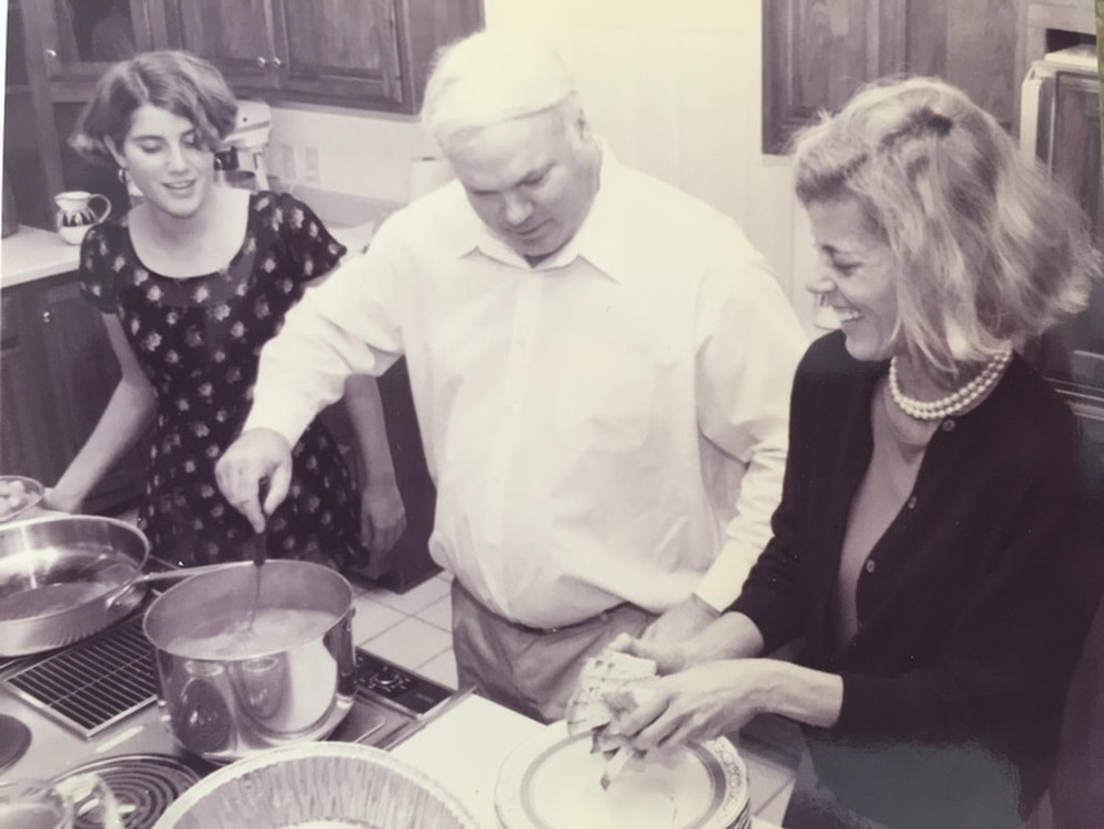 Caroline Pollak, Pat Conroy, and Suzanne Pollak cooking in the kitchen.