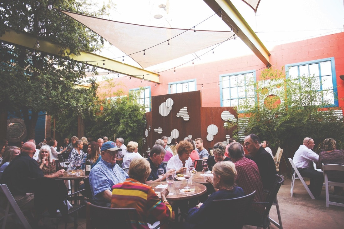 People dining outside a vineyard at McPherson Cellars.