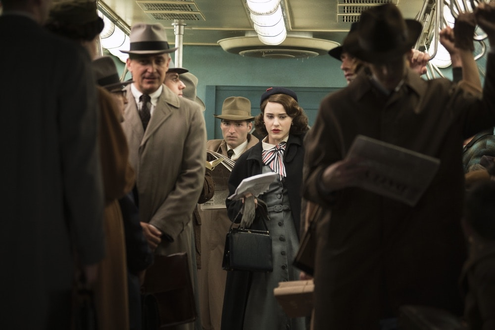 Rachel Brosnahan as Midge Maisel taking a bus into the city