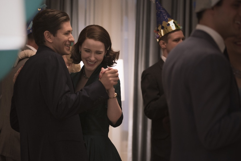 Rachel Brosnahan and Michael Zegen in Season 1 of The Marvelous Mrs. Maisel dancing at a party.
