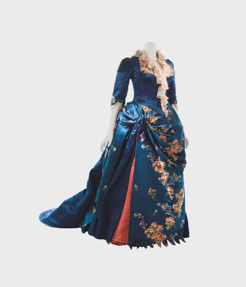 House of Worth blue, afternoon dress in satin brocaded with rose motifs, open skirt front over a panel of coral-colored satin.