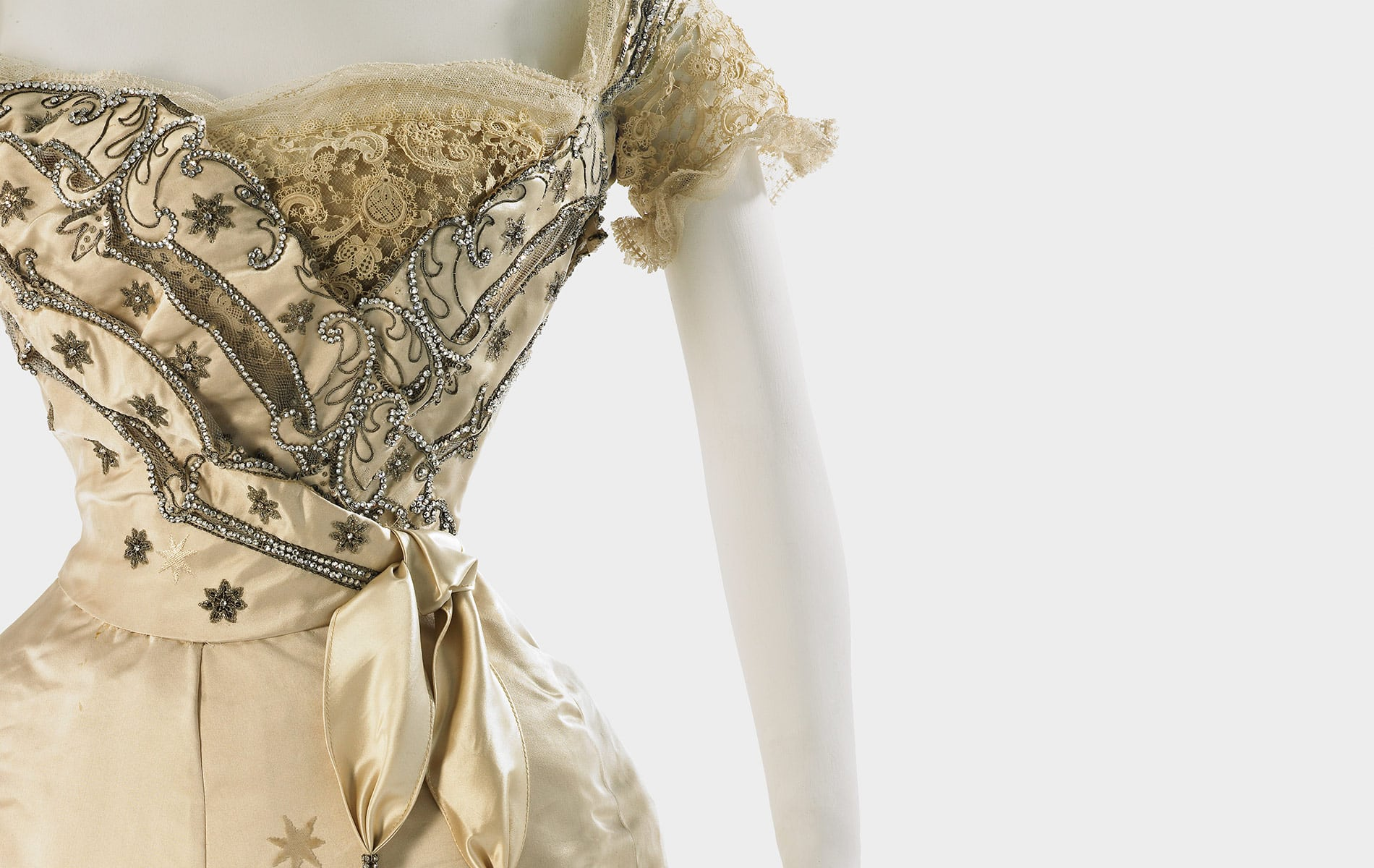 House of Worth, gold evening dress in satin brocade