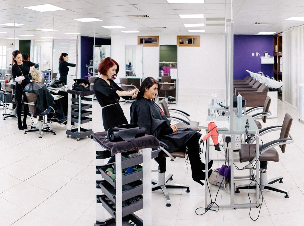 Bellissimo tribe members work with clients at their chic two-story salon and spa location in Galway, Ireland.