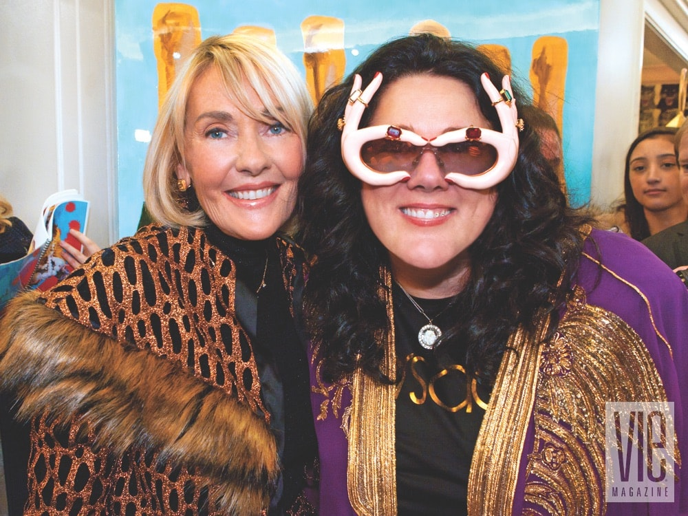 Lisa Burwell and Ashley Longshore at Ashley's pop-up grand opening on the seventh floor at Bergdorf Goodman on January 11, 2018. Photo by Carlo Pieroni