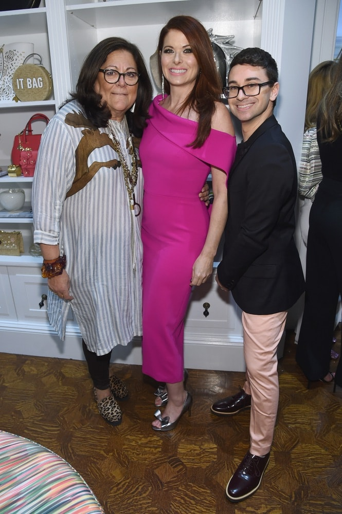 Fern Mallis, Debra Messing, and Christian Siriano attend the opening of Christian Siriano's new store, The Curated NYC, hosted by Alicia Silverstone and sponsored by VIE Magazine on April 17, 2018, in New York City. Photo by Jamie McCarthy/Getty Images for Christian Siriano