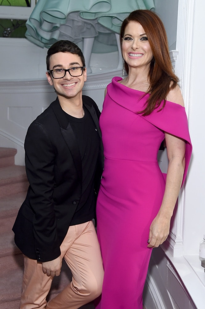 Fashion designer Christian Siriano and actress Debra Messing attend the opening of Christian Siriano's new store, The Curated NYC, hosted by Alicia Silverstone and sponsored by VIE Magazine on April 17, 2018, in New York City. Photo by Jamie McCarthy/Getty Images for Christian Siriano